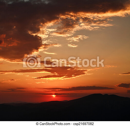 Dramatic sunset with clouds, in mountains, nature background - csp21697082