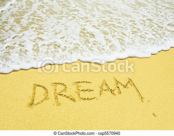 dream word written in the sandy beach - csp5570940