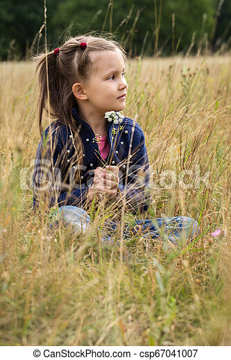 Dreamy girl in a field - csp67041007