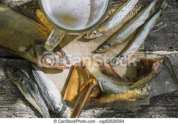 dried fish on wooden background - csp62626564