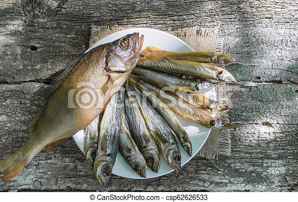 dried fish on wooden background - csp62626533