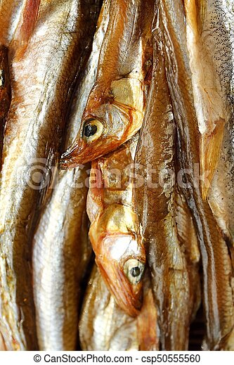 Dried fish with salt on wooden background - csp50555560
