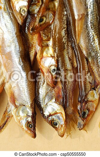 Dried fish with salt on wooden background - csp50555550