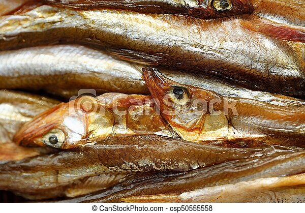 Dried fish with salt on wooden background - csp50555558