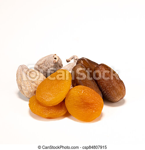 Dried fruit composition, figs, apricots, dates, on white background - csp84807915