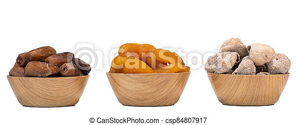 Dried fruit composition, figs, apricots, dates, on white background - csp84807917