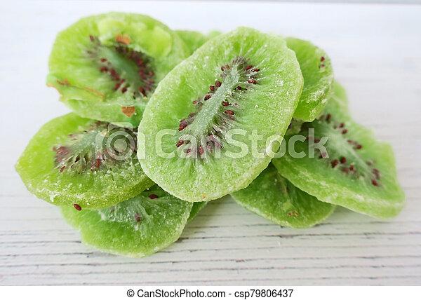 Dried kiwi fruit on white wooden background - csp79806437