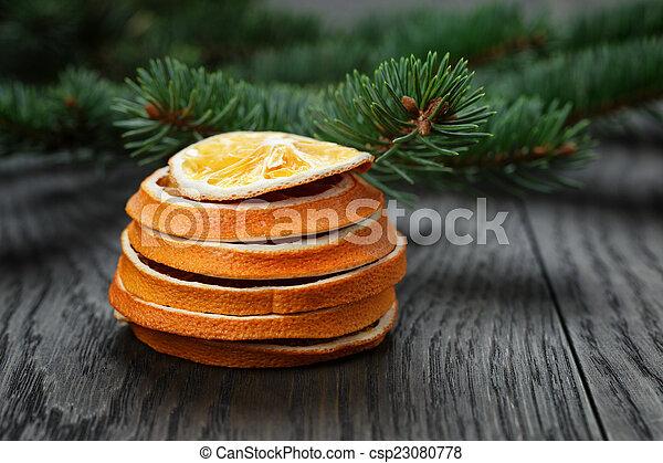 dried orange slices in stack - csp23080778