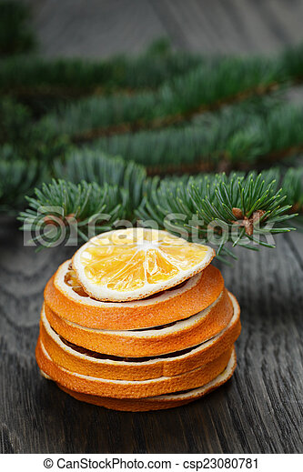 dried orange slices in stack - csp23080781