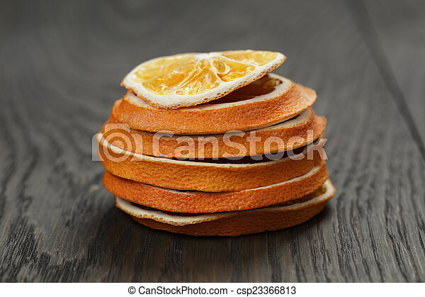 dried orange slices on old table - csp23366813