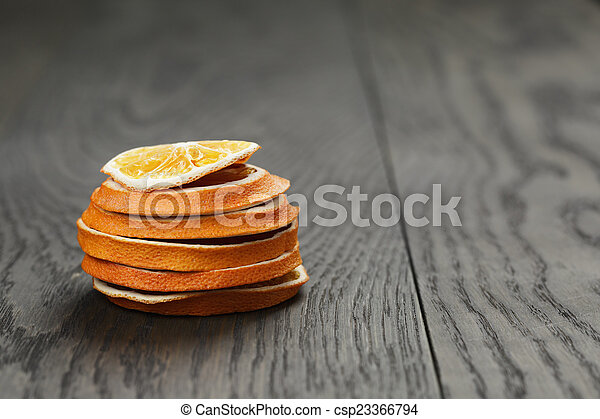 dried orange slices on old table - csp23366794
