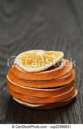 dried orange slices on old table - csp23366831