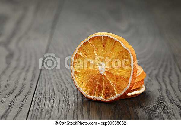 dried orange slices, on wood table - csp30568662