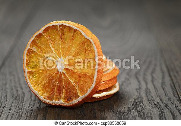 dried orange slices, on wood table - csp30568659