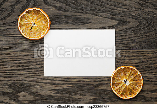 dried orange slices with paper card - csp23366757