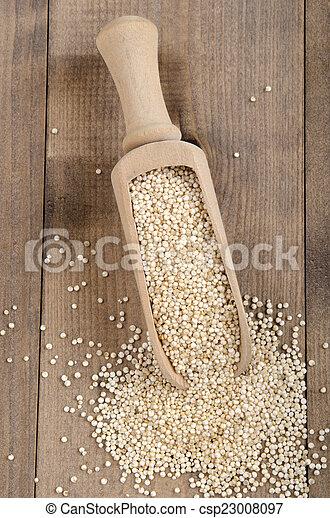 dried quinoa on wooden shovel - csp23008097