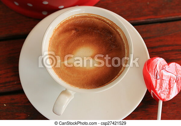 drinking coffee and candy sweet - csp27421529