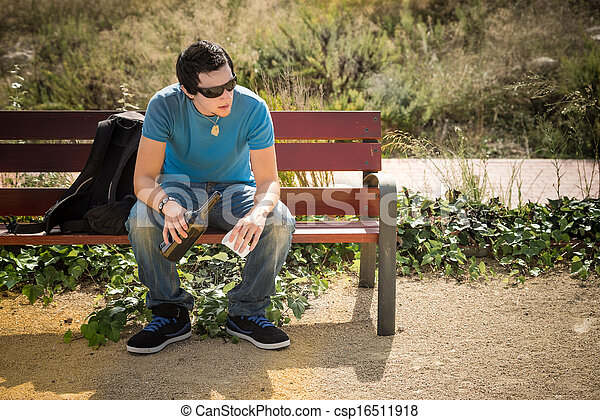 Drinking On The Park Bench Guy Sitting On A Park Bench With A