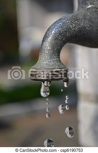 Dripping garden faucet tap close up A garden water faucet tap with