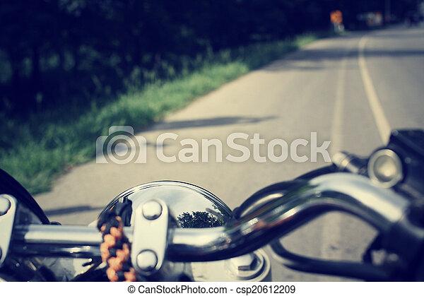 Driver riding motorcycle  - csp20612209