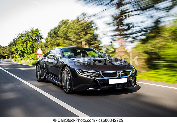 Driving a modern sedan car on the forest road - csp80342729