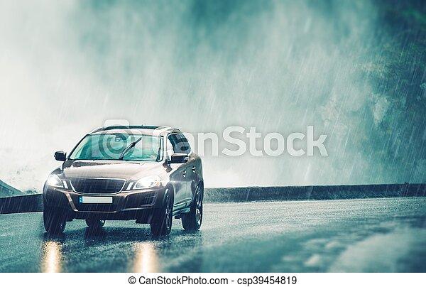 Driving Car in Heavy Rain - csp39454819