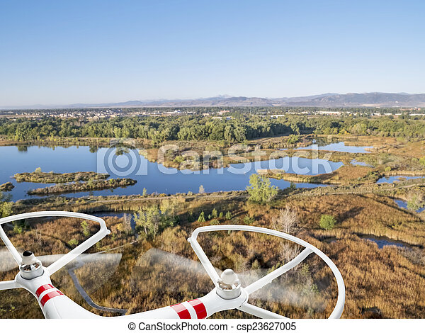 drone flying over lakes and swamp - csp23627005