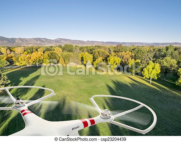 drone flying over park - csp23204439