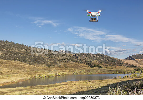 drone flying with a camera - csp22380373