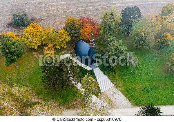 Drone photo of a chapel at Lake Gebart on an autumn morning in City Zalaegerszeg, Hungary - csp86310970