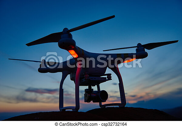 drone quadrocopter with digital camera at sunset - csp32732164