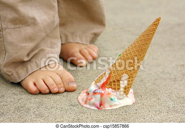 Dropped Ice Cream Cone by Child's Feet - csp15857866