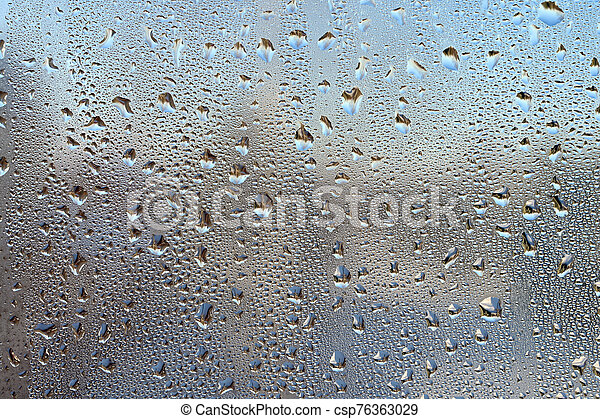 Drops on glass. - csp76363029