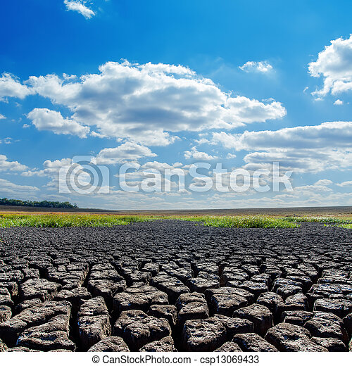 drought earth and blue sky with clouds - csp13069433