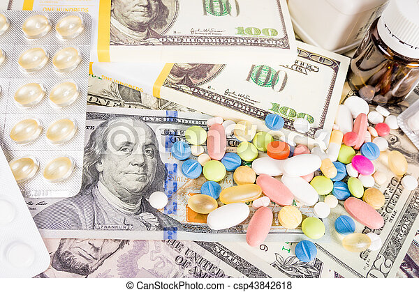drugs on a money background. Money and pills - csp43842618