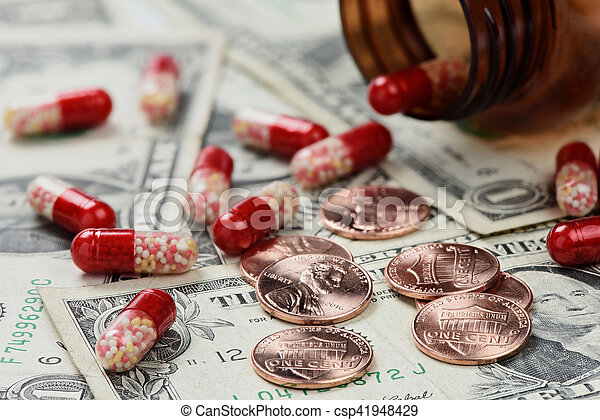 Drugs on money close up - csp41948429