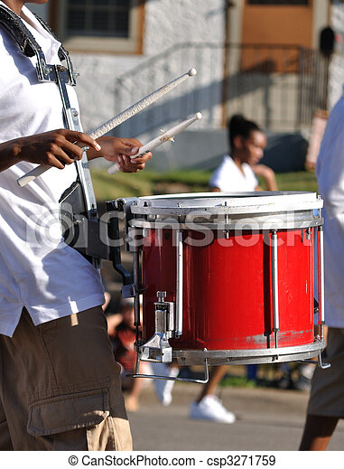 Drummer Playing Red Snare Drums in Parade - csp3271759