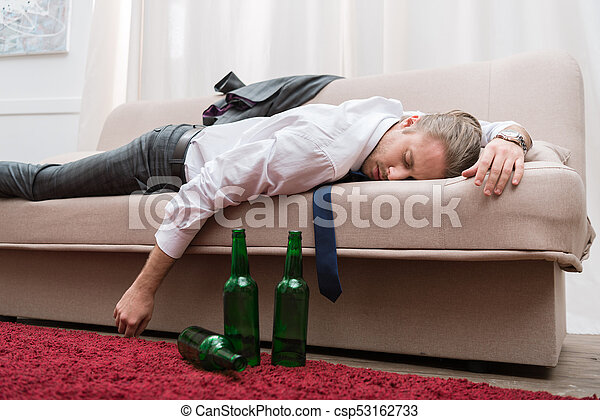 Drunk Man Sleeping On A Sofa In The Living Room