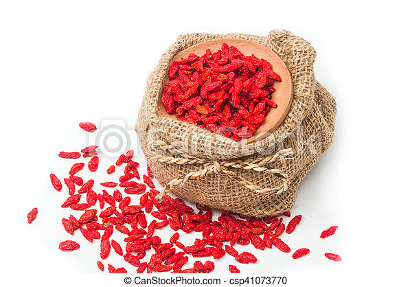 Dry goji berries in clay bowl on white background - csp41073770