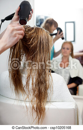 Drying Hair With Blow Dryer - csp10205168