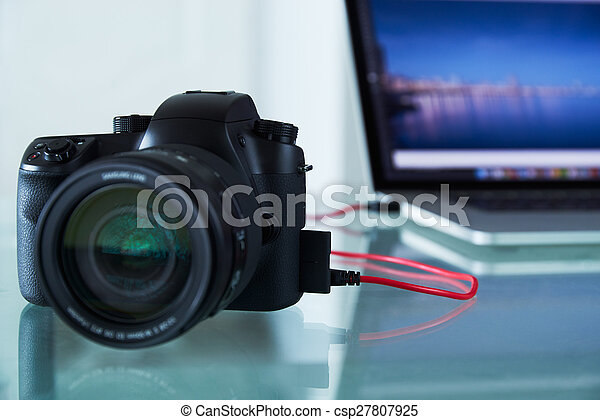 DSLR Photo Camera Tethered To Laptop Computer With USB Cable - csp27807925