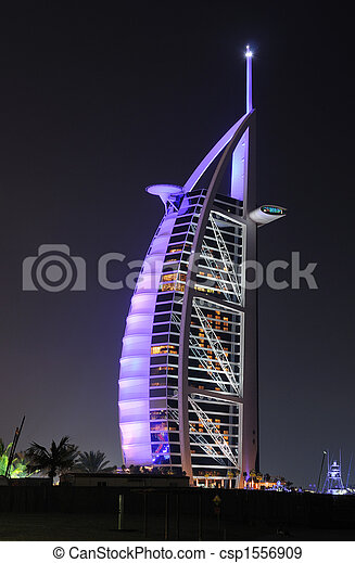 Hotel Burj al arab iluminado por la noche, Dubai - csp1556909