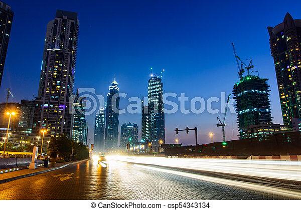 Dubai night city scene with light trails - csp54343134
