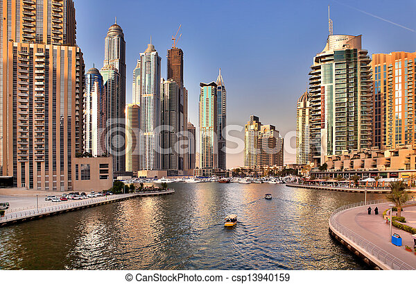DUBAI, UAE - OCTOBER 23: View of the region of Dubai - Dubai Marina is an artificial canal city, carved along a two mile (3 km) stretch of Persian Gulf shoreline on october 23, 2012 in Dubai, UAE  - csp13940159