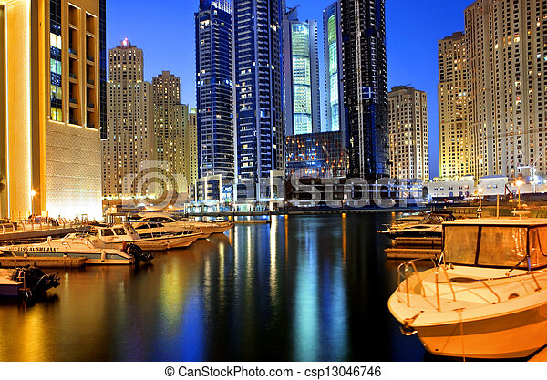 DUBAI, UAE - OCTOBER 23: View of the region of Dubai - Dubai Marina is an artificial canal city, carved along a two mile (3 km) stretch of Persian Gulf shoreline on october 23, 2012 in Dubai, UAE - csp13046746
