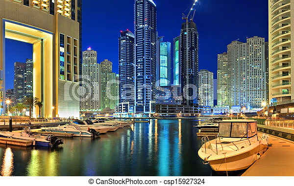 DUBAI, UAE - OCTOBER 23: View of the region of Dubai - Dubai Marina is an artificial canal city, carved along a two mile (3 km) stretch of Persian Gulf shoreline on october 23, 2012 in Dubai, UAE  - csp15927324