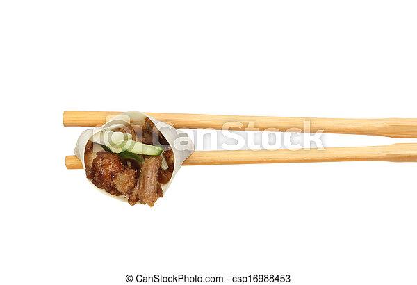 Duck roll in chopsticks - csp16988453