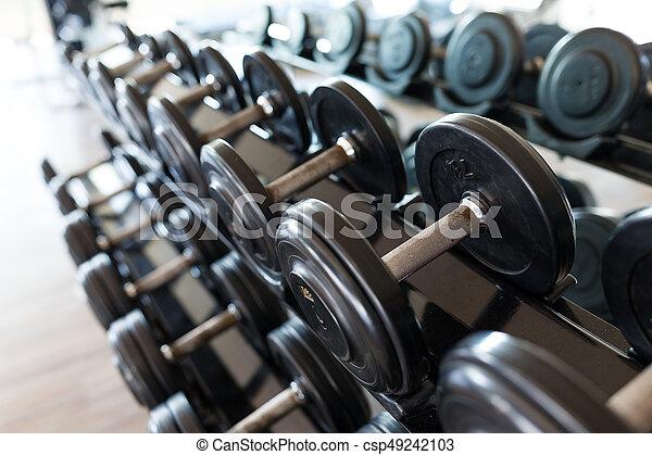 Dumbbell equipment in fitness gym room.