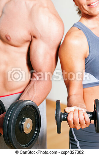 Dumbbell exercise in gym - csp4327382