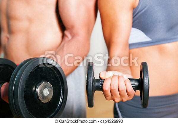Dumbbell exercise in gym - csp4326990